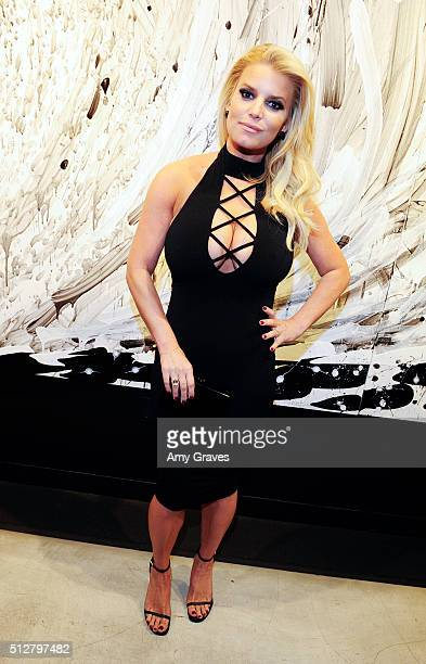 Jessica Simpson attends the Tom Everhart Raw Exhibition of His Schulzinfluenced Paintings For The First Time In Black And White At Mouche Gallery on...