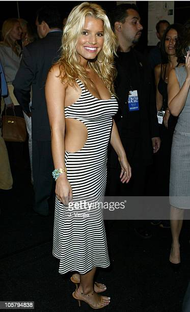 Jessica Simpson during MercedesBenz Fashion Week Spring 2004 Michael Kors Backstage at Gertrude Tent Bryant Park in New York City New York United...