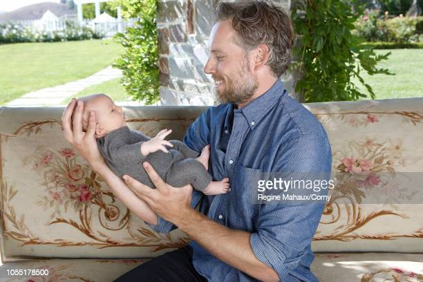 Jessica Simpson Eric Johnson their daughter Maxwell and new son Ace Knute are seen during a photo shoot at their home August 12 2013 in Los Angeles...