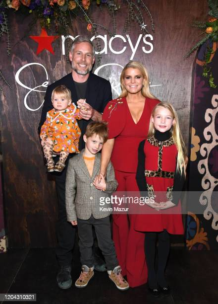 "Jessica Simpson poses with Eric Johnson, Birdie Mae Johnson, Ace Knute Johnson and Maxwell Drew Johnson during a celebration of her memoir ""Open..."