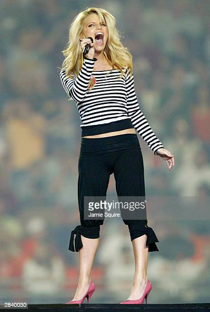 Jessica Simpson sings during half time at the Orange Bowl between the Miami Hurricanes and the Florida State Seminoles on January 1 2004 at the Pro...