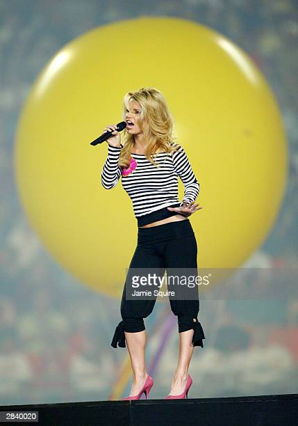 Jessica Simpson sings during halftime at the Orange Bowl between the Miami Huricanes and the Florida State Seminoles January 1 2004 at Pro Player...