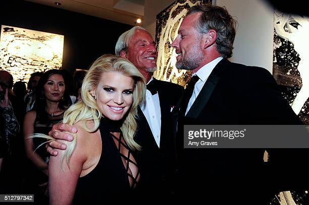 Jessica Simpson Tom Everhart and Eric Johnson attend the Tom Everhart Raw Exhibition of His Schulzinfluenced Paintings For The First Time In Black...