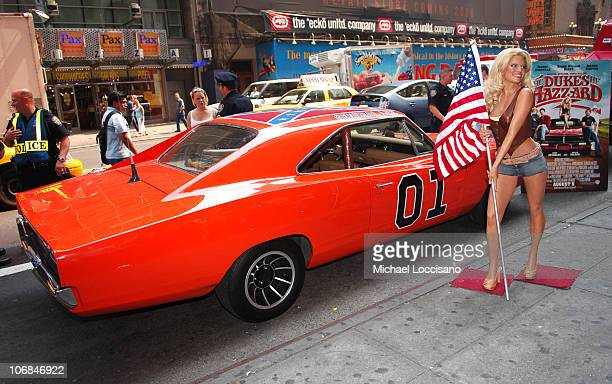 """Jessica Simpson's """"Daisy Duke"""" wax figure with the """"General Lee,"""" a 1969 Dodge Charger from """"The Dukes of Hazzard"""""""