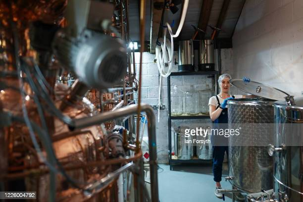 Jessica Slater checks a new batch of sanitising hand rub at the Whitby Gin distillery on May 20, 2020 in York, United Kingdom. The North Yorkshire...
