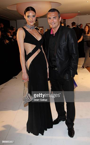 Jessica Sow and Richard Virenque attend the de Grisogono party at the Hotel Du Cap on May 18 2010 in Cap D'Antibes France