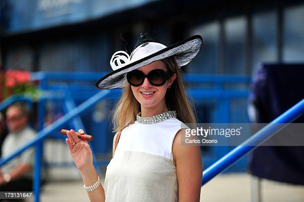 Jessica Steen poses for a photograph at Sunday's Queen's Plate at Woodbine racetrack July 7 2013