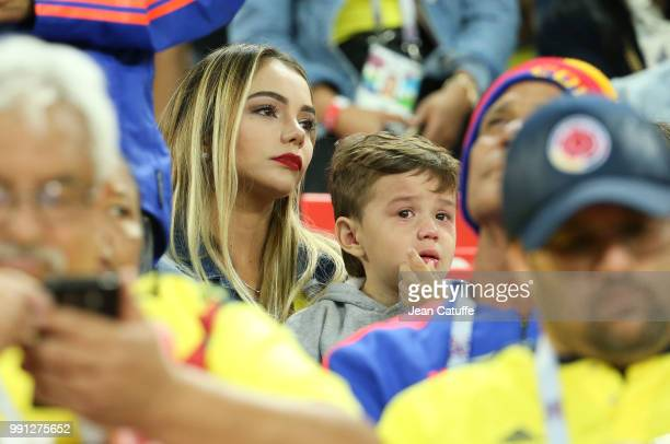 Jessica Sterling wife of David Ospina and their son Max Ospina looking sad following the 2018 FIFA World Cup Russia Round of 16 match between...