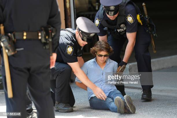 Jessica Stewart of Bass Harbor is arrested protesting the visits of Attorney General Jeff Sessions Friday July 13 2018