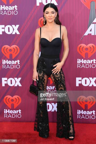 Jessica Szohr arrives at the 2019 iHeartRadio Music Awards which broadcasted live on FOX at Microsoft Theater on March 14 2019 in Los Angeles...