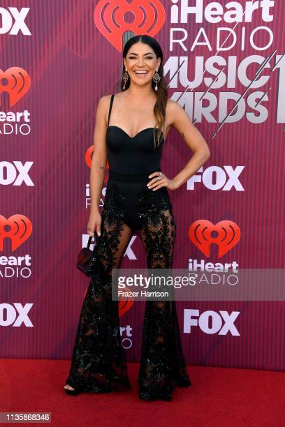 Jessica Szohr attends the 2019 iHeartRadio Music Awards which broadcasted live on FOX at Microsoft Theater on March 14 2019 in Los Angeles California