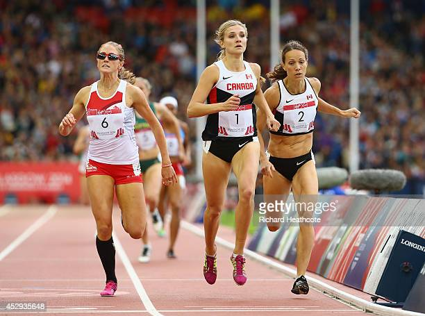 Jessica Tappin of England, Gold medalist Brianne Theisen-Eaton of Canada and silver medalist Jessica Zelinka of Canada sprint to the finish line in...