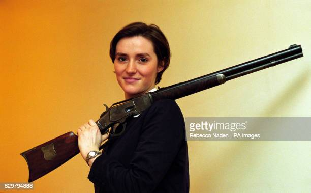 Jessica Thomas of Christie's holds the Winchester rifle specially made for legendary sharpshooter Annie Oakley
