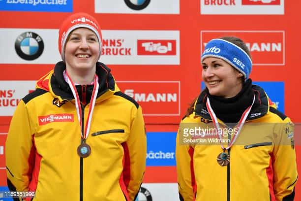 Jessica Tiebel and Julia Taubitz of Germany smile at the medal ceremony during the FIL Luge World Cup at OlympiaRodelbahn on November 23 2019 in...