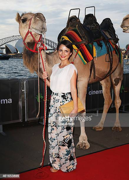 Jessica Tovey poses alongside a camel at the St George Openair Cinema Tracks premiere on January 10 2014 in Sydney Australia