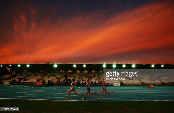 Jessica Trengove of South Australia and Celia Sullohern of New South Wales run in the Womens 10000 Meter Run Open Zatopek race during Zatopek 10 at...