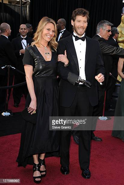 Jessica Trusty and writer Aron Ralston arrive at the 83rd Annual Academy Awards held at the Kodak Theatre on February 27 2011 in Hollywood California