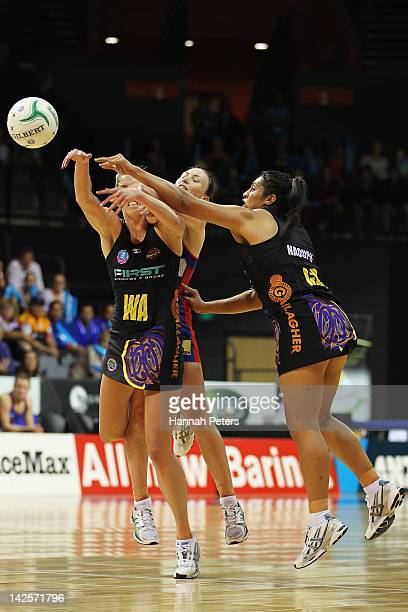 Jessica Tuki and Julianna Naoupu of the Magic competes with Jade Clarke of the Mystics during the round two ANZ Championship match between the...