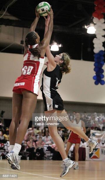 Jessica Tuki of New Zealand jumps for the ball against Geva Mentor of England during the Final match at the World Netball Youth Championships on July...