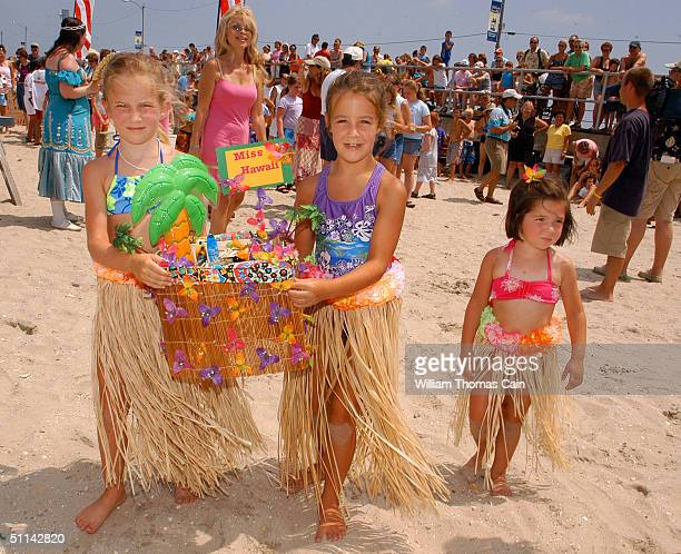Jessica Tyrell Patti Dolaway and Hailey Tyrell of Maple Glenn Pennsylvania dress in hula girl outfits and show off their Hawaiian themed hermit crab...