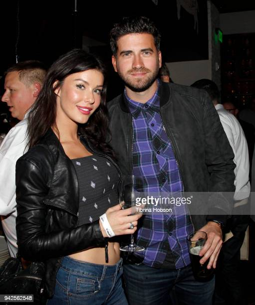 Jessica Vargas and Ryan Rottman attend Yardbird's Southern Table Bar Los Angeles grand opening on April 5 2018 in Los Angeles California