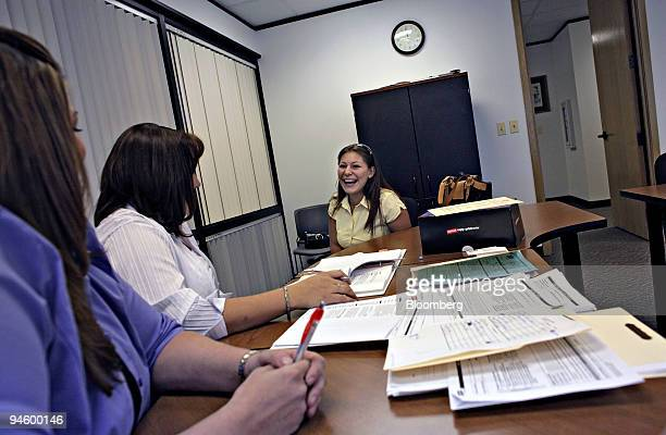Jessica Vargas right laughs during a job interview with Michele Townsend general manager of a local Staples store center and Melissa Reinhart the...