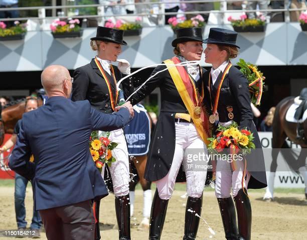 Jessica von BredowWerndl Isabell Werth and Helen Langehanenberg celebrate during the Longines Balve Optimum award ceremony on June 16 2019 in Balve...