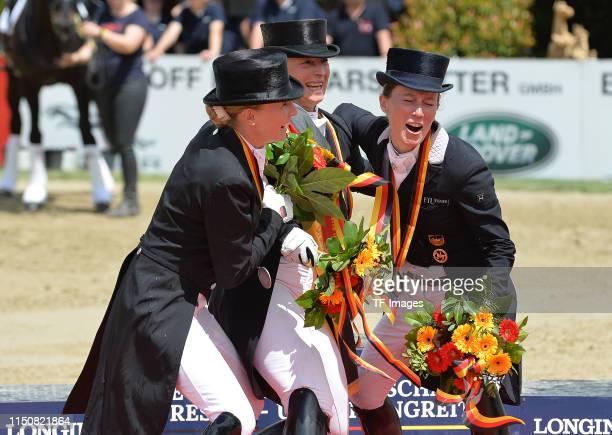 Jessica von BredowWerndl Isabell Werth and Helen Langehanenberg celebrate during the Longines Balve Optimum dressage competition on June 16 2019 in...