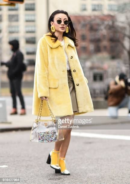 Jessica Wang is seen wearing a yellow fur coat and Chanel bag outside the Brock Collection show during New York Fashion Week Women's A/W 2018 on...