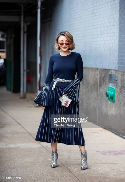 Jessica Wang is seen wearing pleated skirt navy jumper outside Jonathan Simkhai during New York Fashion Week Fall / Winter on February 10 2020 in New...