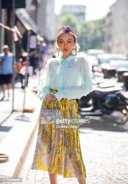 Jessica Wang seen wearing golden pleated skirt silver bag sheer blouse outside the Pucci during Milan Fashion Week Spring/Summer 2020 on September 19...
