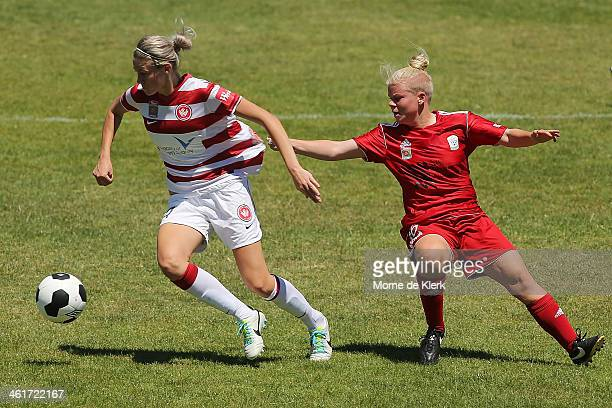 Jessica Waterhouse of Adelaide competes for the ball with Alanna Kennedy of the Wanderers during the round 8 WLeague match between Adelaide United...