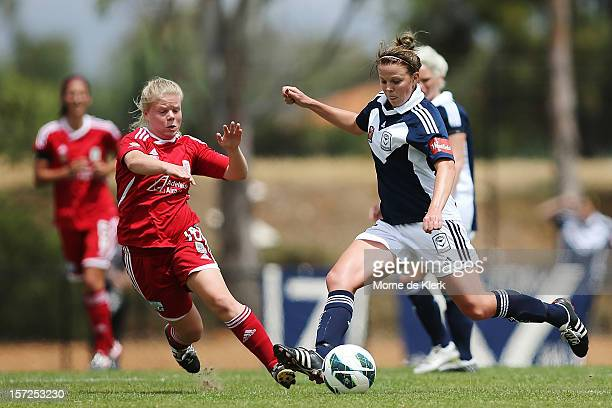 Jessica Waterhouse of Adelaide competes with Amy Jackson of Melbourne during the round seven WLeague match between Adelaide United and the Melbourne...