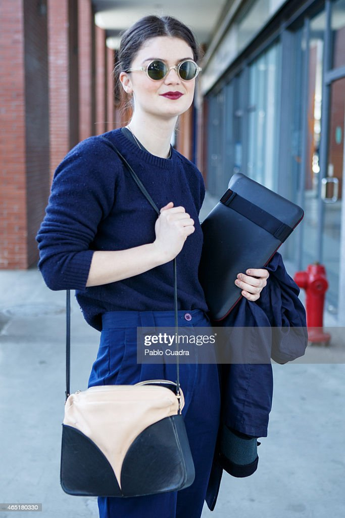 Jessica wears & Other Stories shoes and handbag, American Apparel trousers and UniQlo jumper on March 3, 2015 in Madrid, Spain.