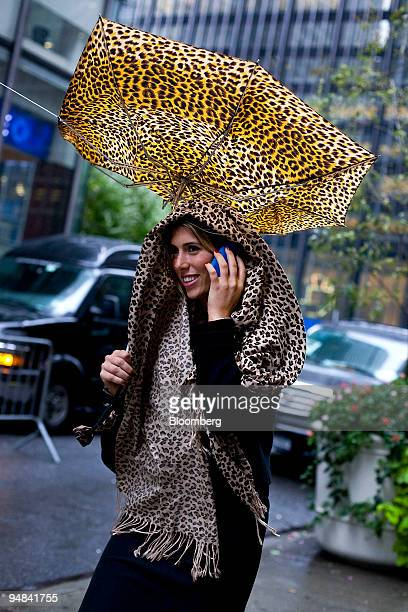 Jessica Weinraub's umbrella flips inside out as she walks in New York US on Friday Sept 26 2008 An Atlantic storm drenched New York City today...