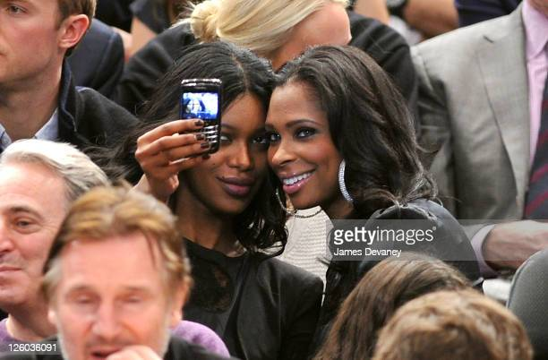 Jessica White and guest attend the Miami Heat vs New York Knicks game at Madison Square Garden on December 17 2010 in New York City