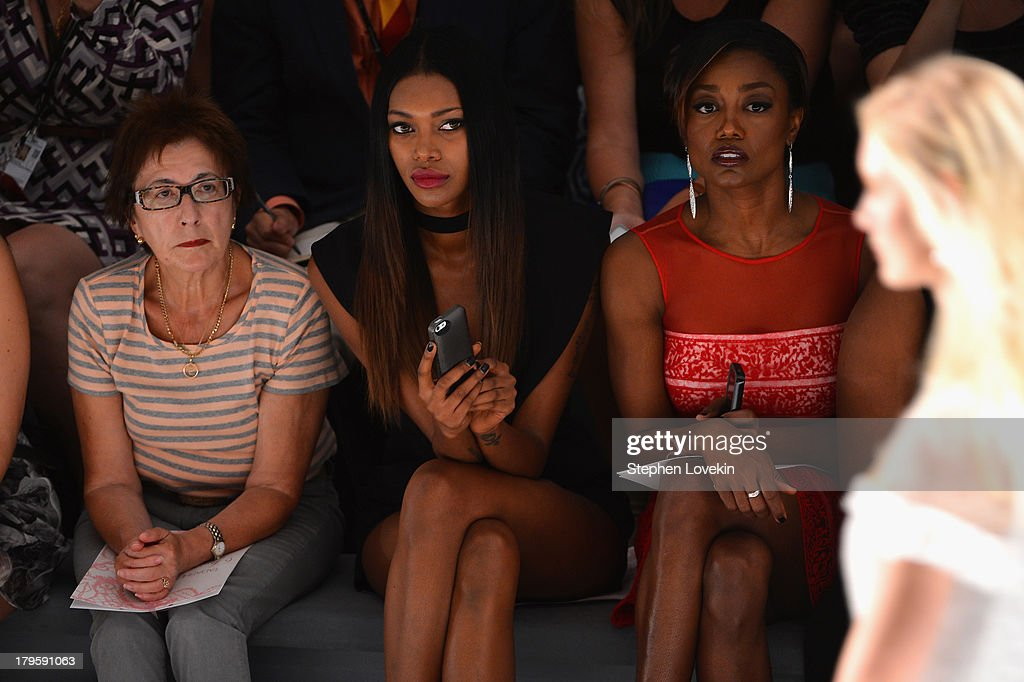 Jessica White and Patina Miller attend the Tadashi Shoji Spring 2014 fashion show during Mercedes-Benz Fashion Week at The Stage at Lincoln Center on September 5, 2013 in New York City.