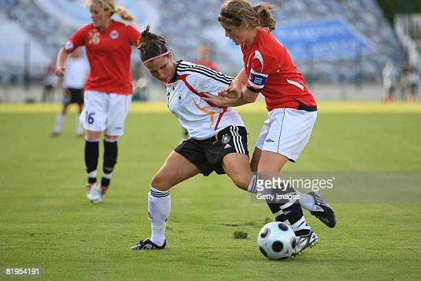 Jessica Wich of Germany and Maren Mjelde of Norway fight for the ball during the Women's U19 European Championship match between Germany and Norway...