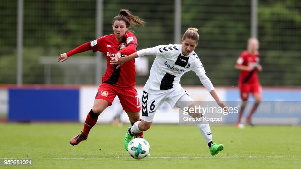 Jessica Wich of Leverkusen challenges Daria Streng of Freiburg II during the Second FrauenBundesliga Suedstaffel match between Bayer Leverkusen and...