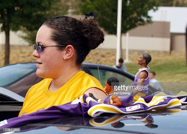 Jessica Willenberg of Gypsum Colorado talks with reporters in front of the Eagle County Courthouse and shows her support for Kobe Bryant by wearing a...