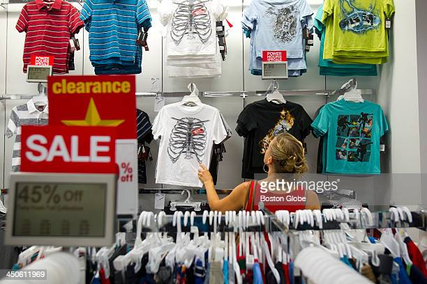 Jessica Wood scans clothing racks for clothes during an earlybird sale at Kohl's Anne Low and Jessica Wood took Jessica's children Maisie and Emmett...
