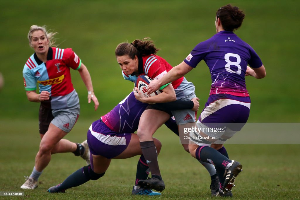 Jessica Wooden of Harelquins looks to break through the Loughborough defence line during the Harlequins Ladies v Loughborough Lightning Tyrrells Premier 15s match at Surrey Sports Park on January 13, 2018 in Guildford, England.