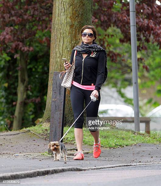 Jessica Wright is pictured taking her pet dog out for a morning walk on May 6 2015 in London England