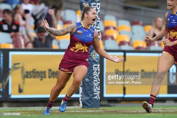 Jessica Wuetschner of the Lions celebrates a goal during the round eight AFLW match between the Brisbane Lions and the North Melbourne Kangaroos at...