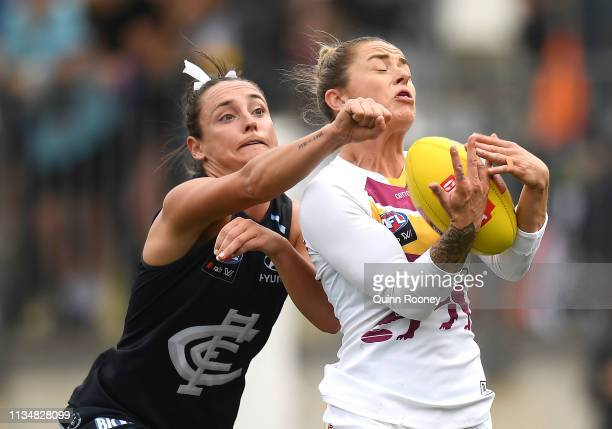 Jessica Wuteschner of the Lions marks during the round six AFLW match between the Carlton Blues and the Brisbane Lions at Ikon Park on March 10, 2019...