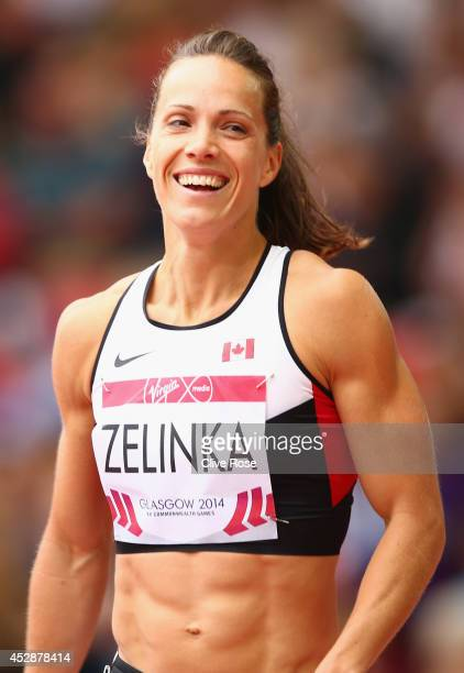 Jessica Zelinka of Canada smiles after competing in the Women's Heptathlon 100 metres hurdles at Hampden Park during day six of the Glasgow 2014...
