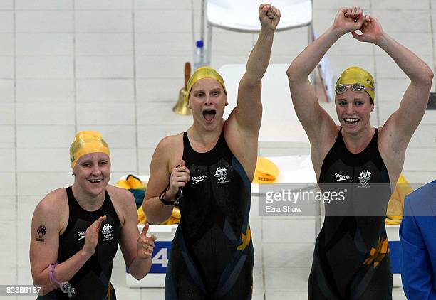 Jessicah Schipper Leisel Jones and Emily Seebohm celebrate after their team won the gold medal with a world record time of 35269 in the Women's...