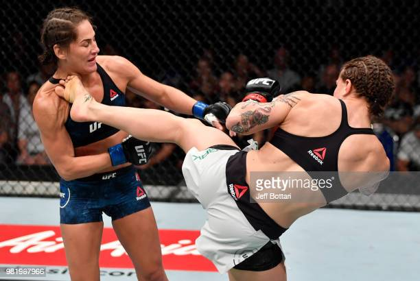 JessicaRose Clark of Australia kicks Jessica Eye in their women's flyweight bout during the UFC Fight Night event at the Singapore Indoor Stadium on...