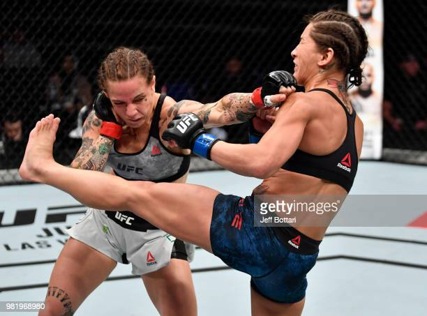JessicaRose Clark of Australia punches Jessica Eye in their women's flyweight bout during the UFC Fight Night event at the Singapore Indoor Stadium...