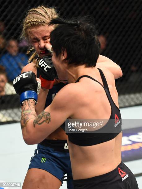 JessicaRose Clark of Australia punches Paige VanZant in their women's flyweight bout during the UFC Fight Night event inside the Scottrade Center on...